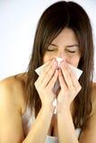 Sneezes doentes da menina Fotos de Stock Royalty Free