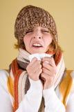 Sneezes frios da menina Foto de Stock Royalty Free