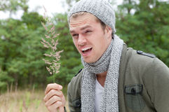Sneezing. Man sneezing because of allergy Stock Photography