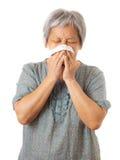 Sneezing asian elderly woman Stock Photos