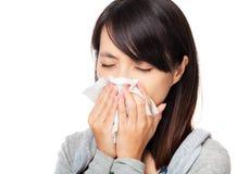 Sneezing asian woman Stock Photo