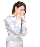 Sneezing asian young woman. On white background Royalty Free Stock Photo