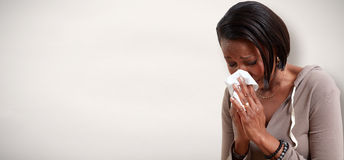 Sneezing black women Royalty Free Stock Photo