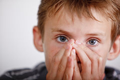 Sneezing boy Royalty Free Stock Images