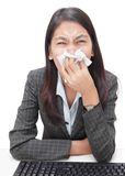 Sneezing businesswoman w flu Royalty Free Stock Image