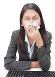 Sneezing businesswoman w flu Royalty Free Stock Image