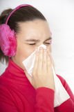 A sneezing cute young woman Stock Photos