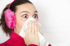 A sneezing cute young woman Royalty Free Stock Image