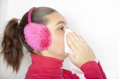 A sneezing cute young woman Royalty Free Stock Photography