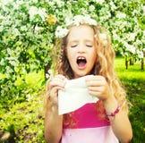 Sneezing girl Stock Photo