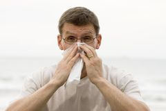 Sneezing man Stock Images