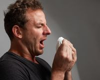 Sneezing man with cold Royalty Free Stock Photography