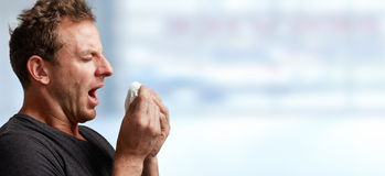 Sneezing man with cold Stock Image