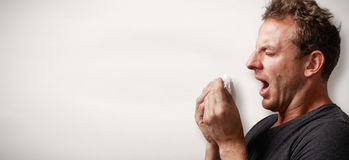 Sneezing man with cold Stock Photo
