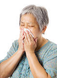 Sneezing mature asian woman Royalty Free Stock Photography