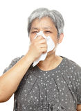 Sneezing mature woman Stock Photography