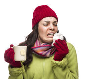 Sneezing Mixed Race Woman Drinks Hot Tea While Blowing Nose royalty free stock photography