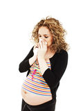 Sneezing pregnant woman Stock Image