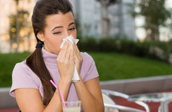 Sneezing teenage girl Stock Images