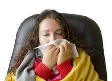 Sneezing into tissue Stock Photos