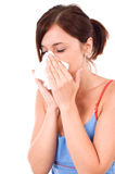 A sneezing woman Stock Image