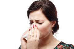 Sneezing woman Stock Image
