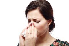 Sneezing woman Stock Image