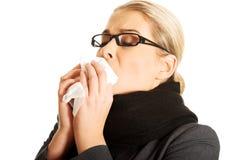 Sneezing woman Royalty Free Stock Photo