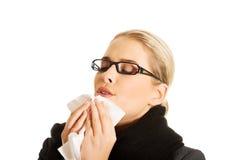 Sneezing woman Royalty Free Stock Image