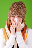 Sneezing woman with handkerchief Stock Images