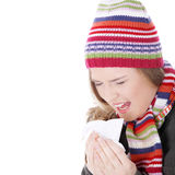 Sneezing woman with handkerchief Stock Photography