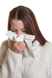 Sneezing woman has the flu Royalty Free Stock Images
