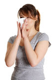 Sneezing Woman having cold or allergy. Royalty Free Stock Images