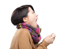 Sneezing young attractive woman holding wipe Stock Image