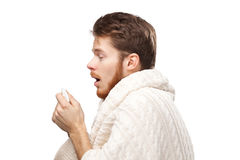 Sneezing young man holding wipes Stock Photo