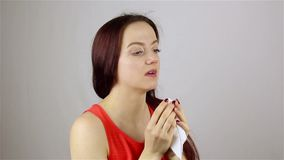 Sneezing a young woman stock video