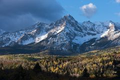The Sneffels Mountain Range in early Autumn viewed from a county road in South Western Colorado. The Sneffels Mountain Range in early Autumn, located within the stock image