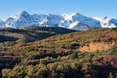 The Sneffels Mountain Range in early Autumn viewed from the the Dallas Divide, Colorado. Mount Sneffels Mountain Range with a fresh early autumn snow. Aspen royalty free stock images