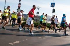 Snel lopende mensen Stock Foto's