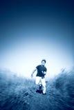 Snel lopende mensen blauwe tint Stock Foto's