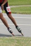 Snelheid gealigneerde het Schaatsen samenvatting van vleten en schaatser royalty-vrije stock afbeelding