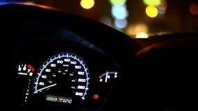 Snelheidsmeter laat - nacht met bokeh Stock Fotografie