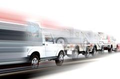 Snelle auto's op een rij Stock Afbeeldingen