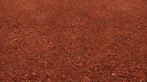 Röd komposttäckningsäng Royaltyfri Foto