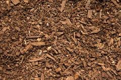 Snickareträpartiklar på golvet som en bakgrund arkivfoton