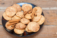 Snicker doodle cookies with cinnamon. On wooden table royalty free stock photography