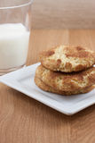 Snicker Doodle Cookies. On a white plate and a glass of milk Stock Images