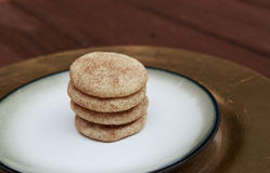 Snickerdoodle cookies stacked on a golden plate Royalty Free Stock Image
