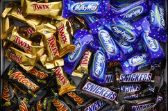 Snickers, Mars, Milky Way and Twix minis candy bars in the box Stock Images