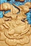 Snida ängeln som rider lejonet Arkivbild